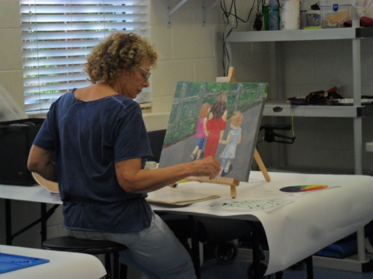 Sue working with acrylics