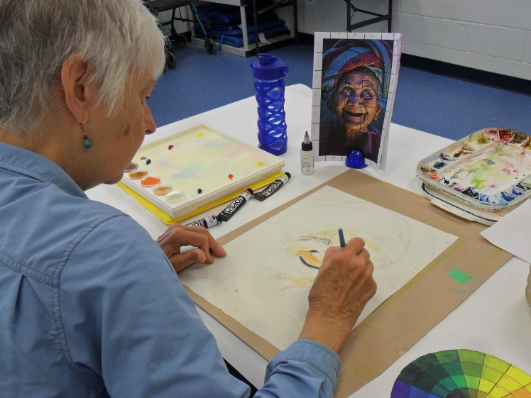 Sue working with watercolor & acrylic